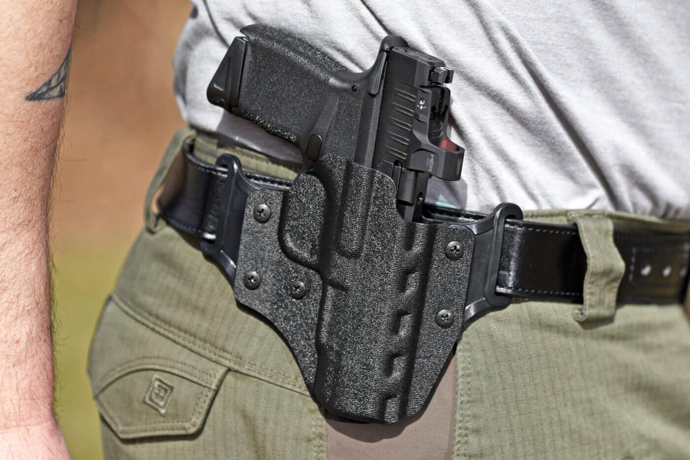 Man wearing DeSantis Veiled Partner holster with pistol