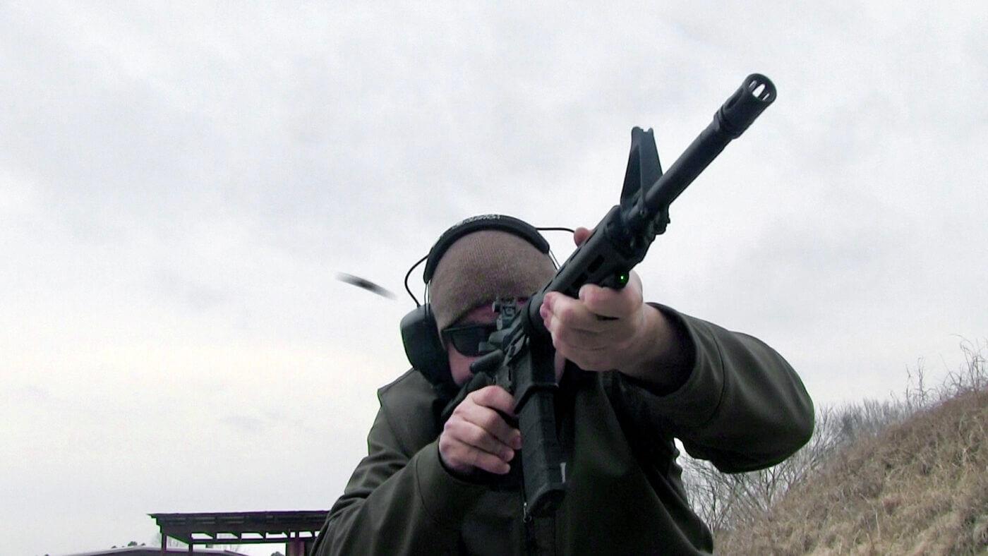 Man shooting a SAINT rifle