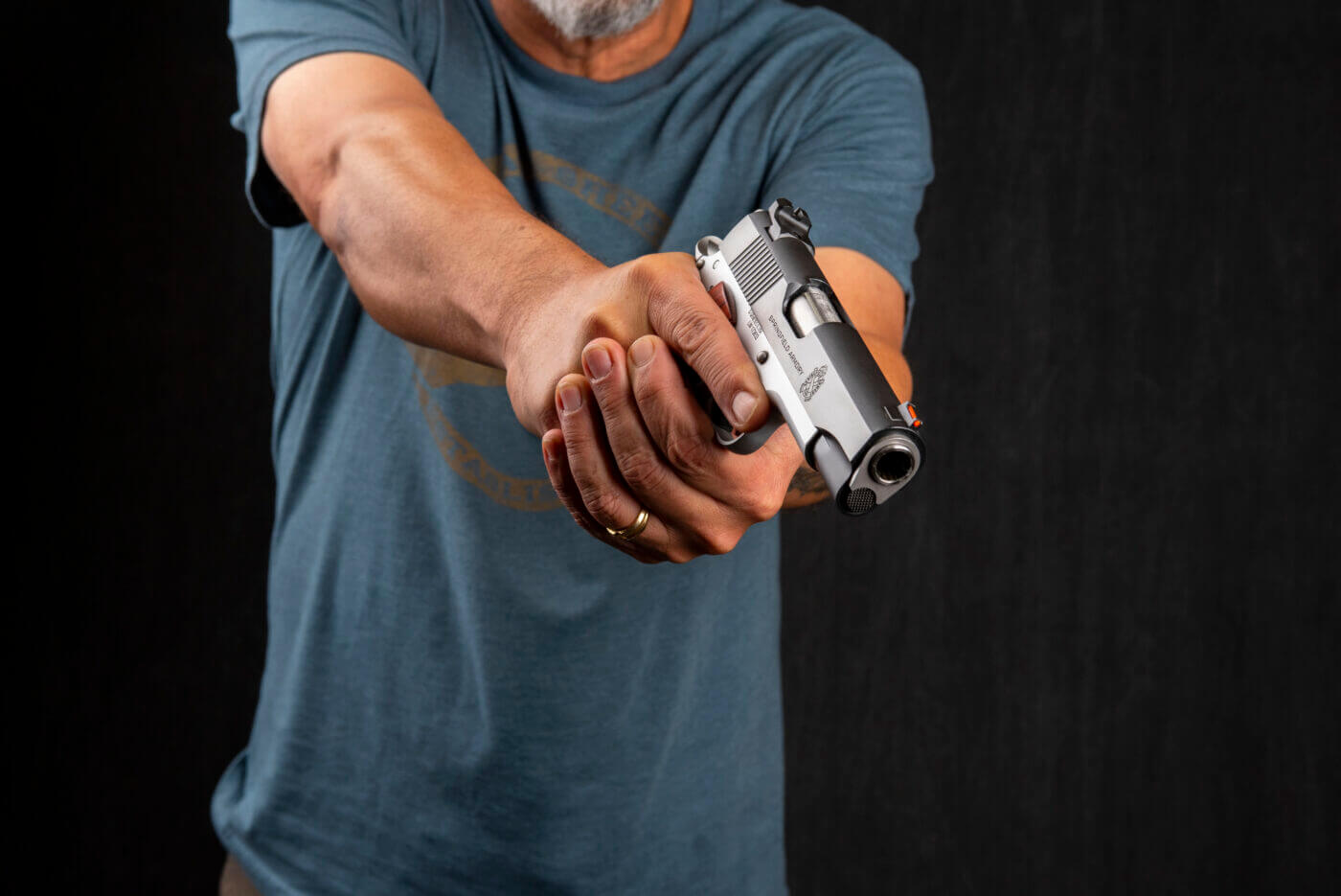 Man with Springfield 1911 pistol