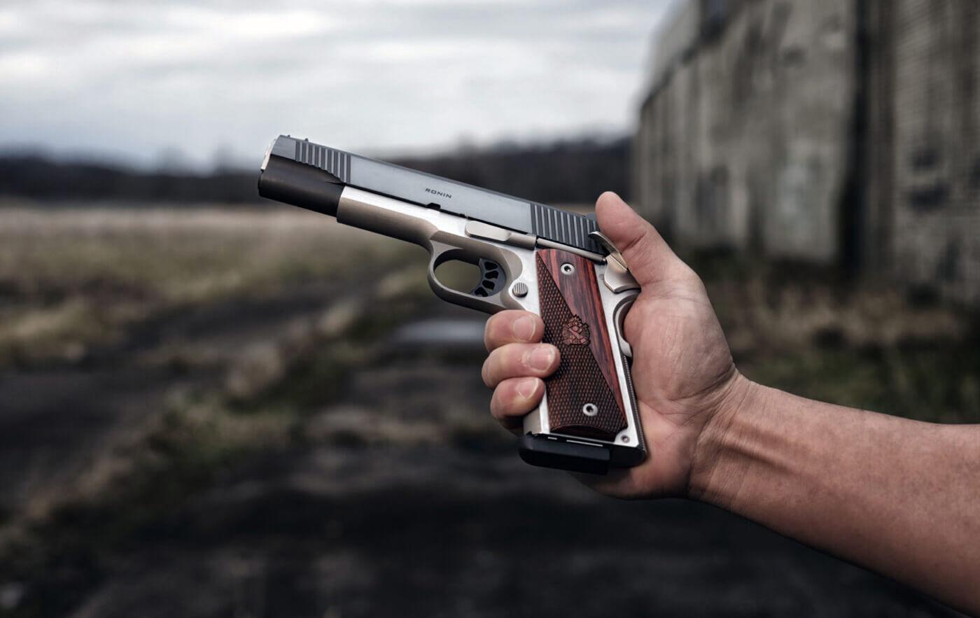 Holding a Ronin 1911 pistol