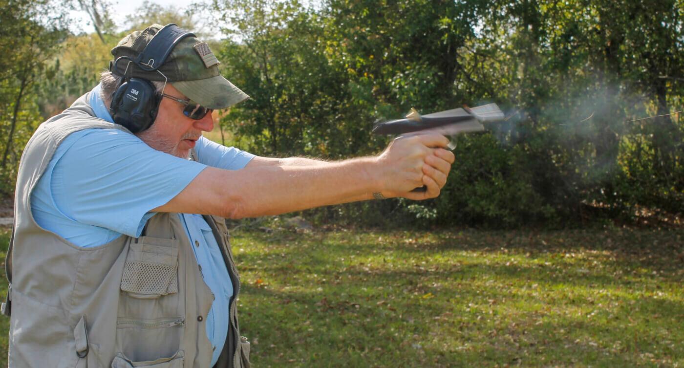 Man shooting a 1911 pistol