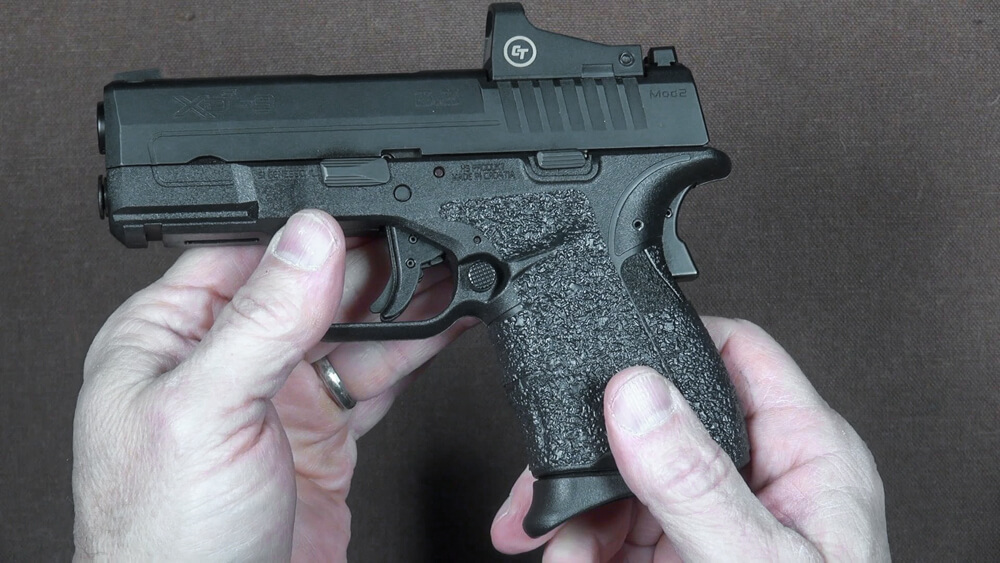 Heat and press the adhesive onto gun after installing new grips