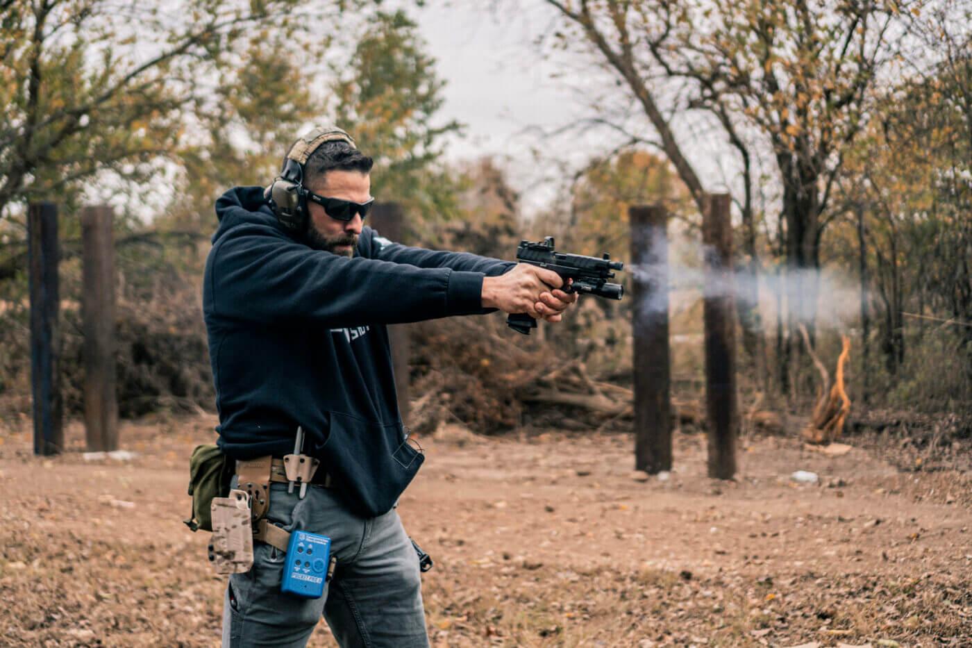 Man shooting a Springfield XD-M Elite Tactical OSP