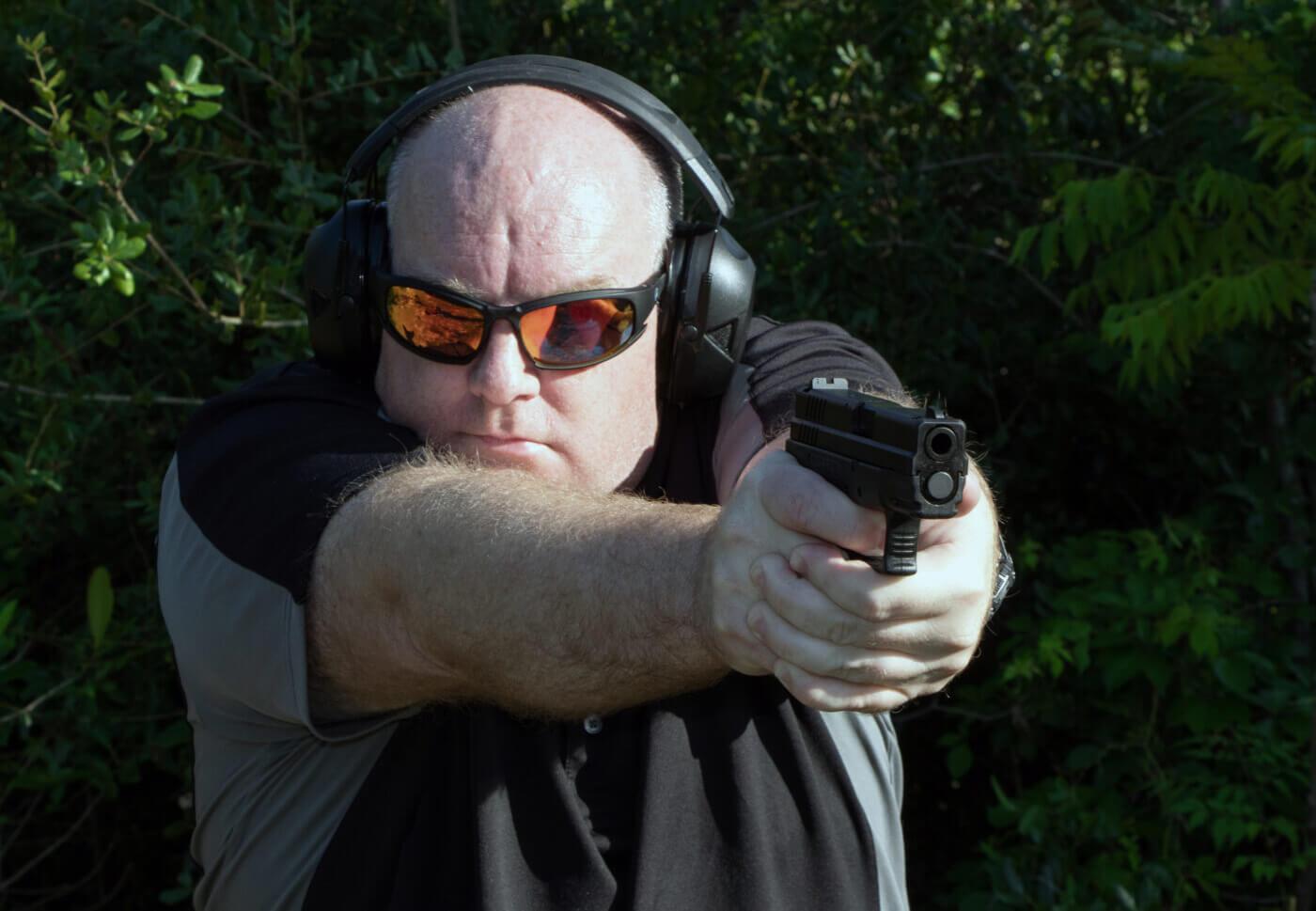 Man shooting the Springfield XD Sub-Compact