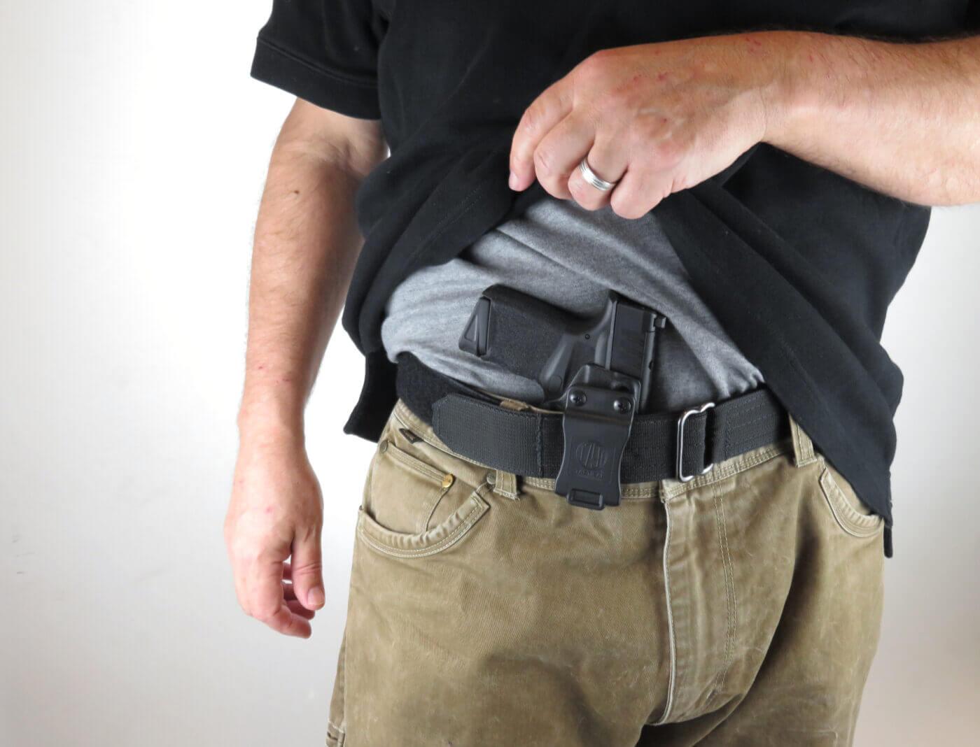 Man showing holster under a shirt