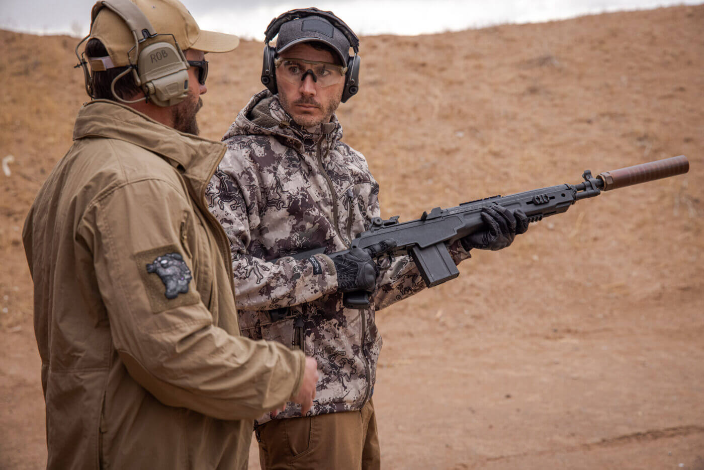 Testing M1A rifle with suppressor on the range