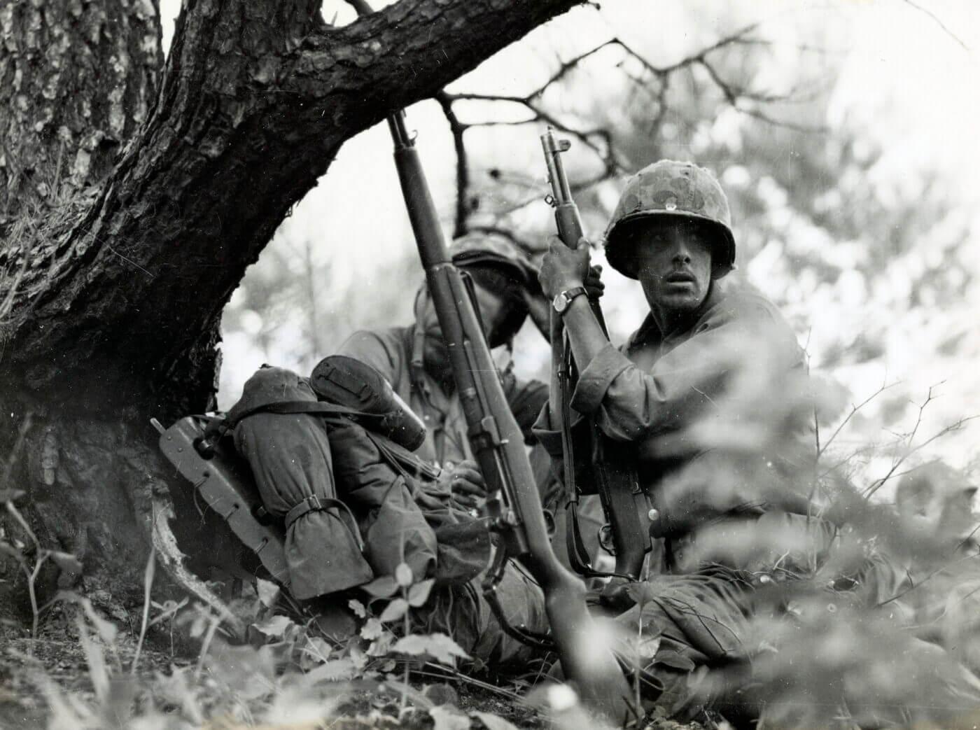 Korean War USMC soldier on hillside with M1 Garand