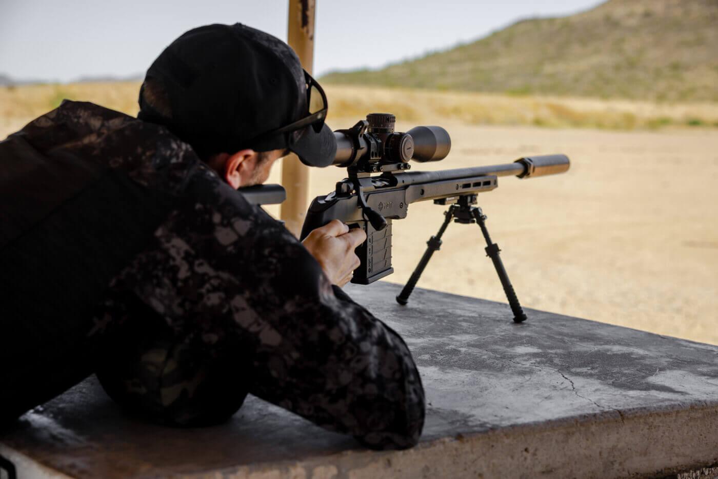 Shooting rifle at precision rifle training