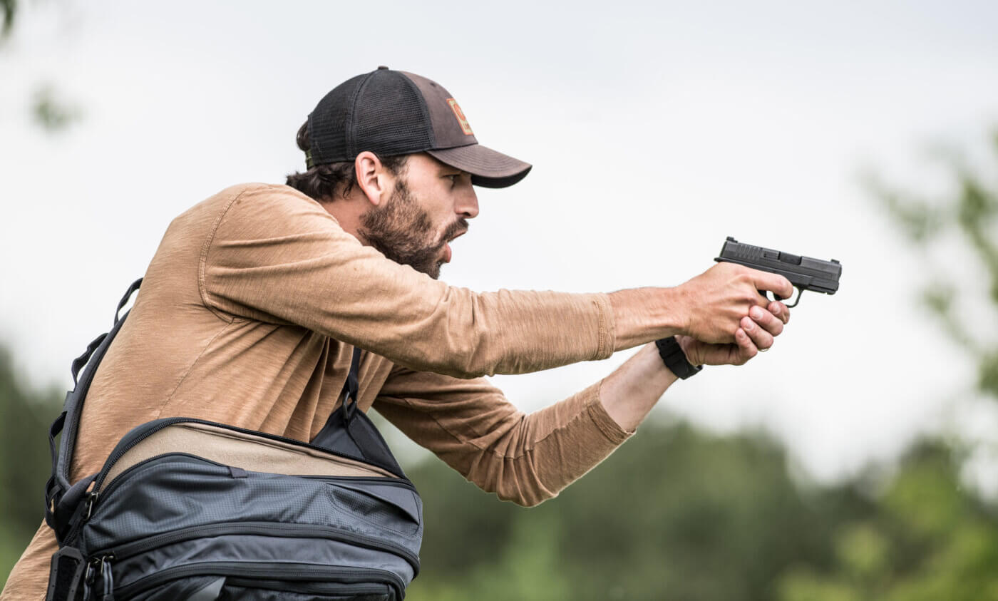 Man shooting a gun to defend himself