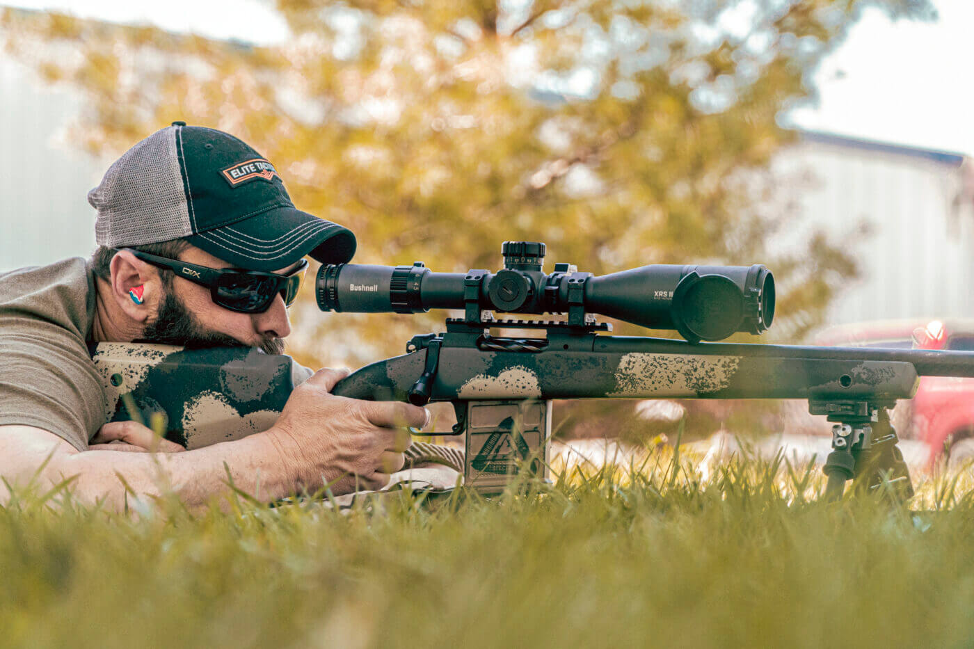 Man shooting a rifle at long range