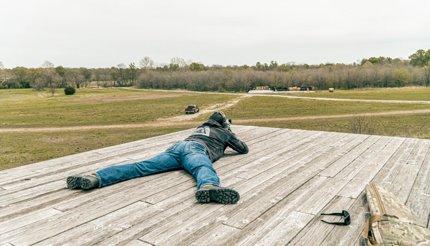 Man shooting long range with natural alignment to target