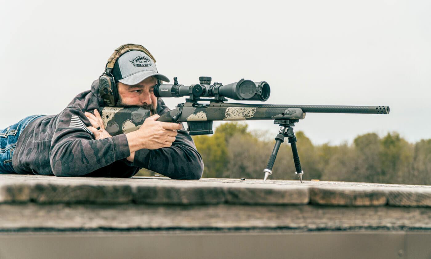 Man shooting a rifle on a bipod