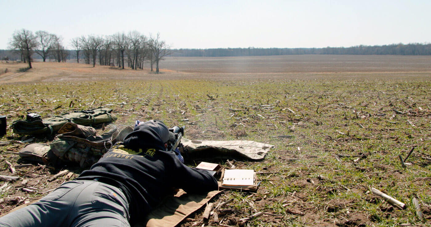 Man shooting long distance from prone position
