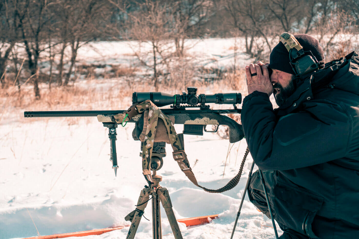 Predator hunting with a rifle on a tripod