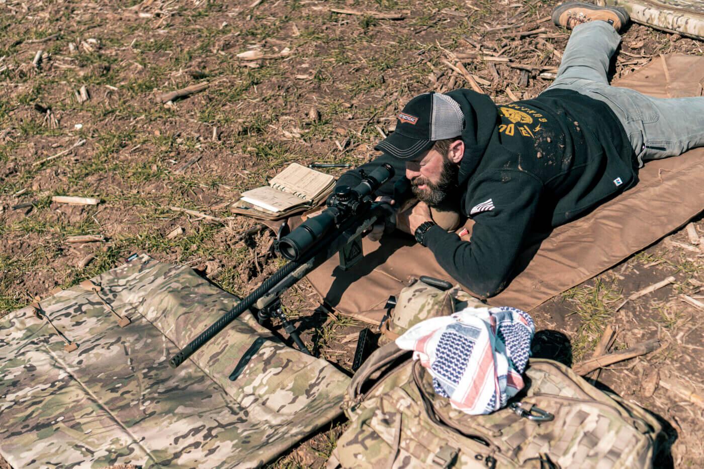 Man shooting rifle long range