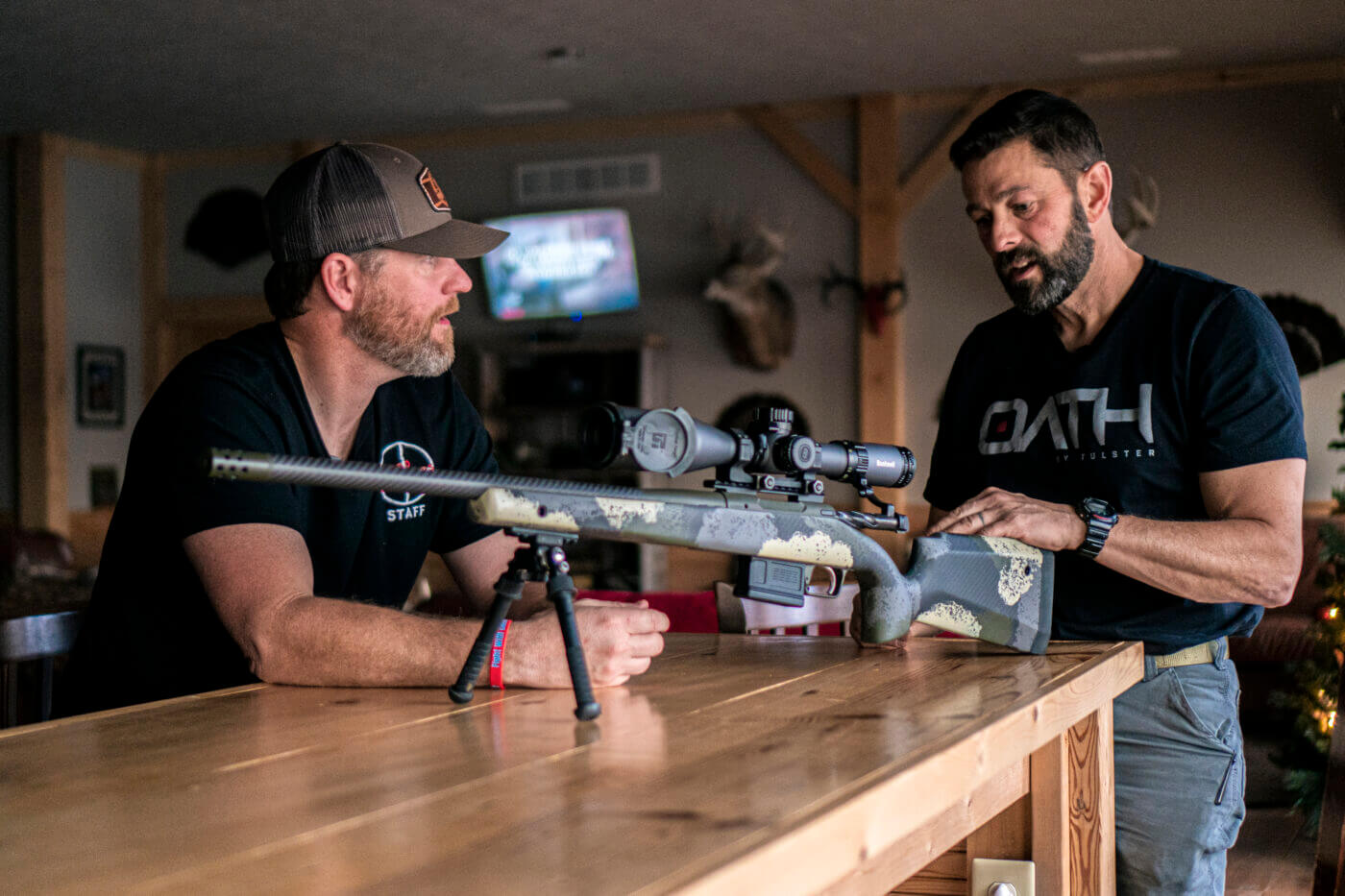 Men standing and talking about Springfield Armory Model 2020 Waypoint rifle