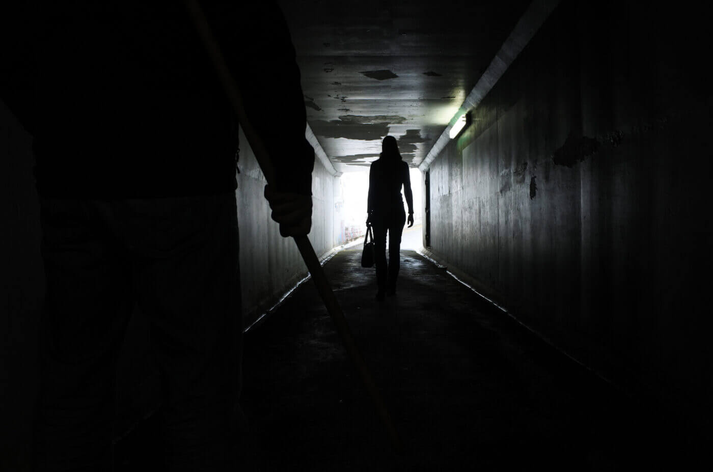 Stranger in dark tunnel and man with knife