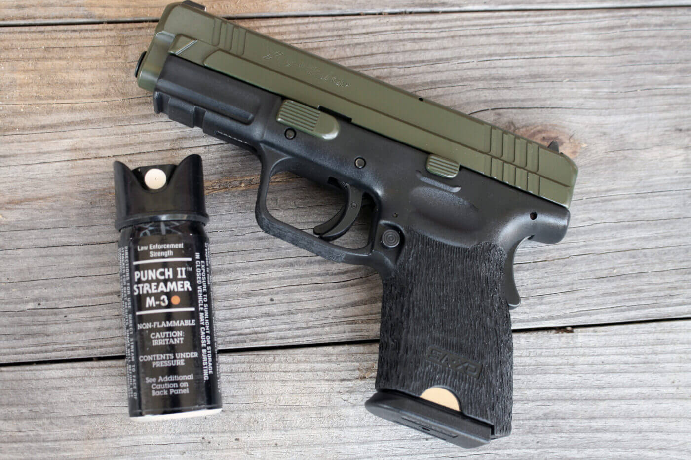 Pepper spray and a pistol