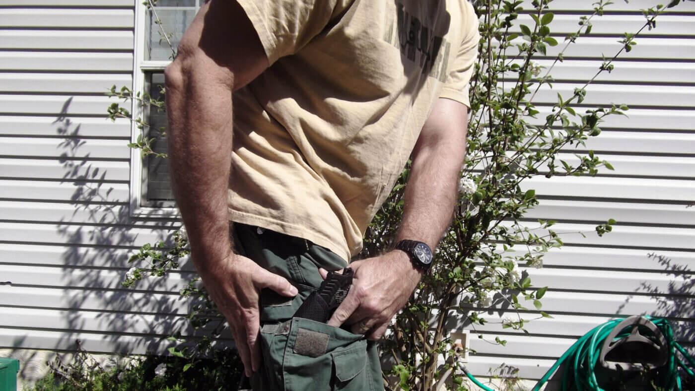 Cross draw carry of 911 pistol
