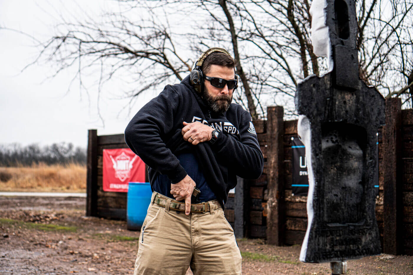 Man demonstrating how to shoot an attacker in close quarters
