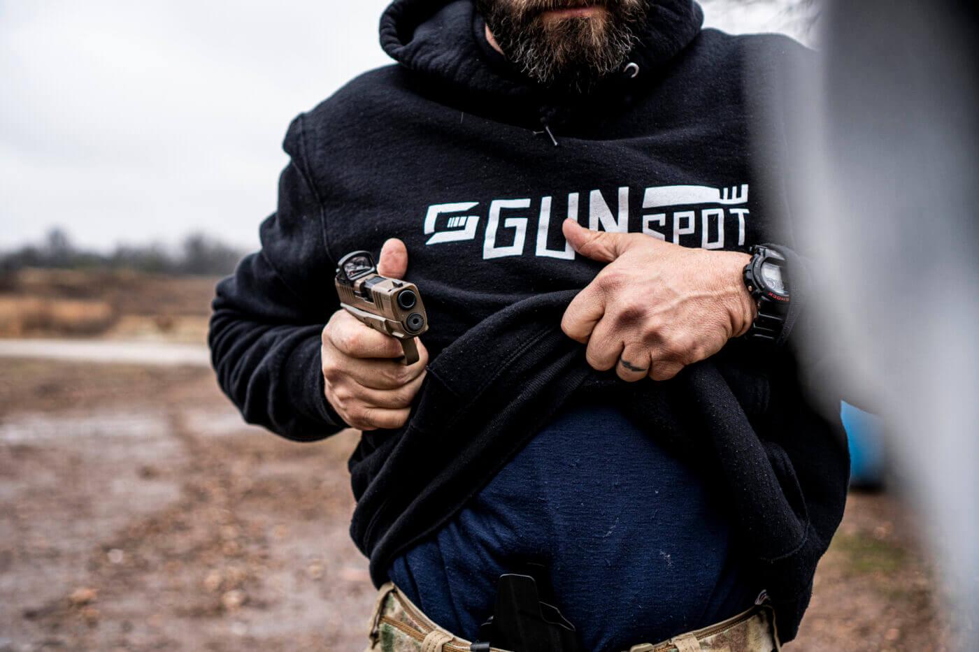 Man rotating the gun to the target
