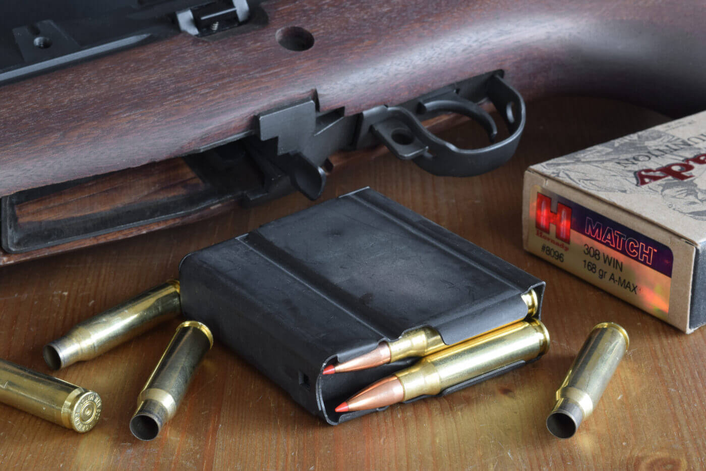 .308 ammo in a rifle magazine with rifle in background