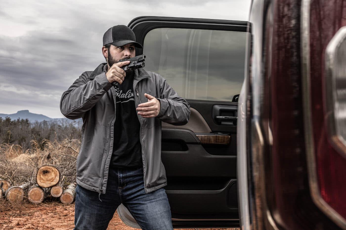 Man using Springfield Armory Professional Light Rail 9mm pistol as an EDC weapon