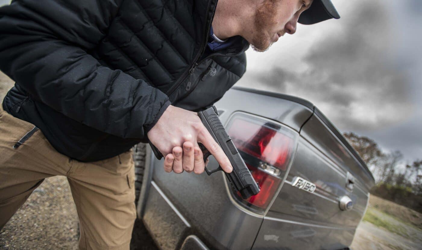 Man using Springfield Armory XD-M handgun as a truck gun