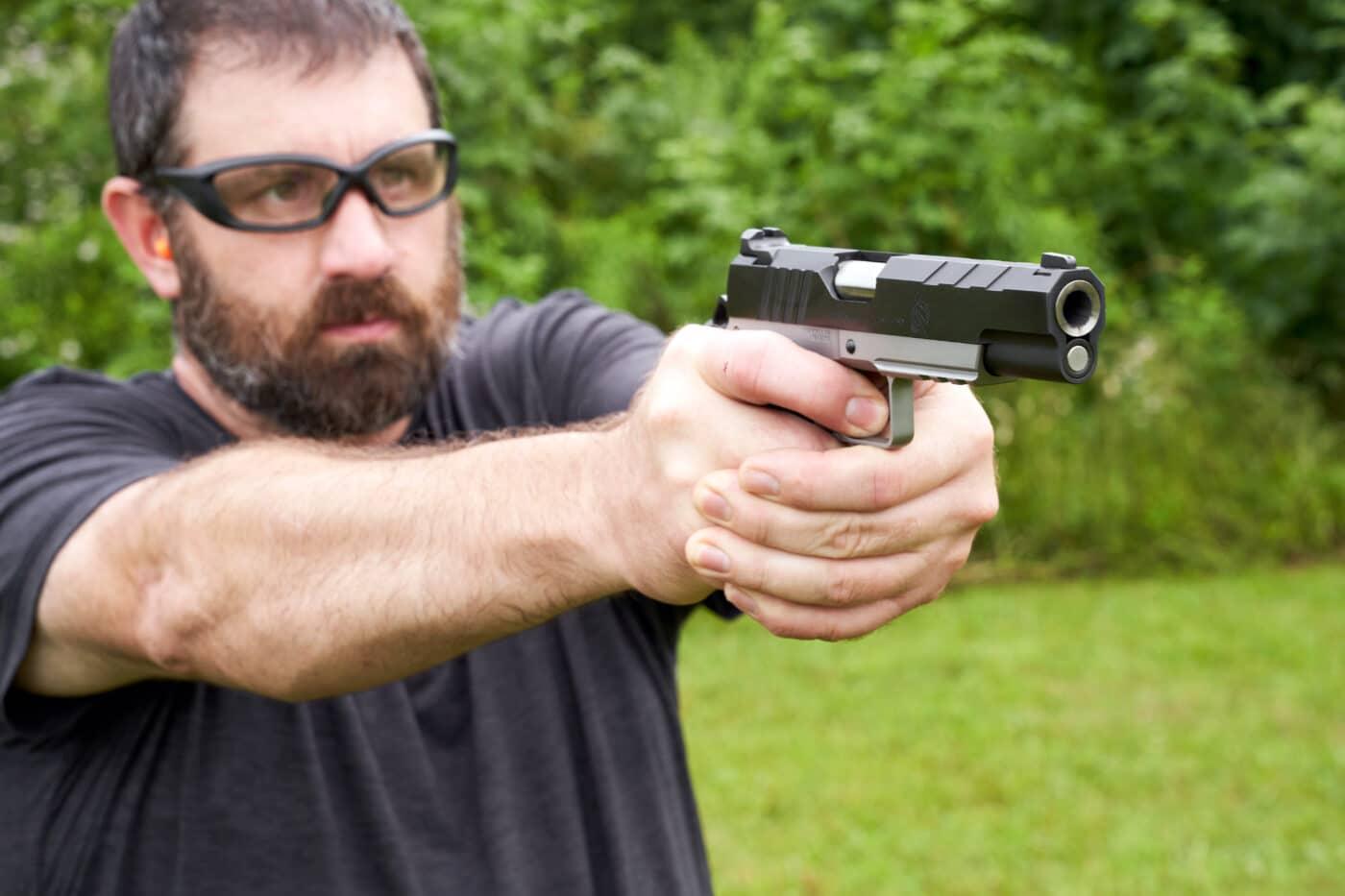 Man shooting the SA Emissary on the range