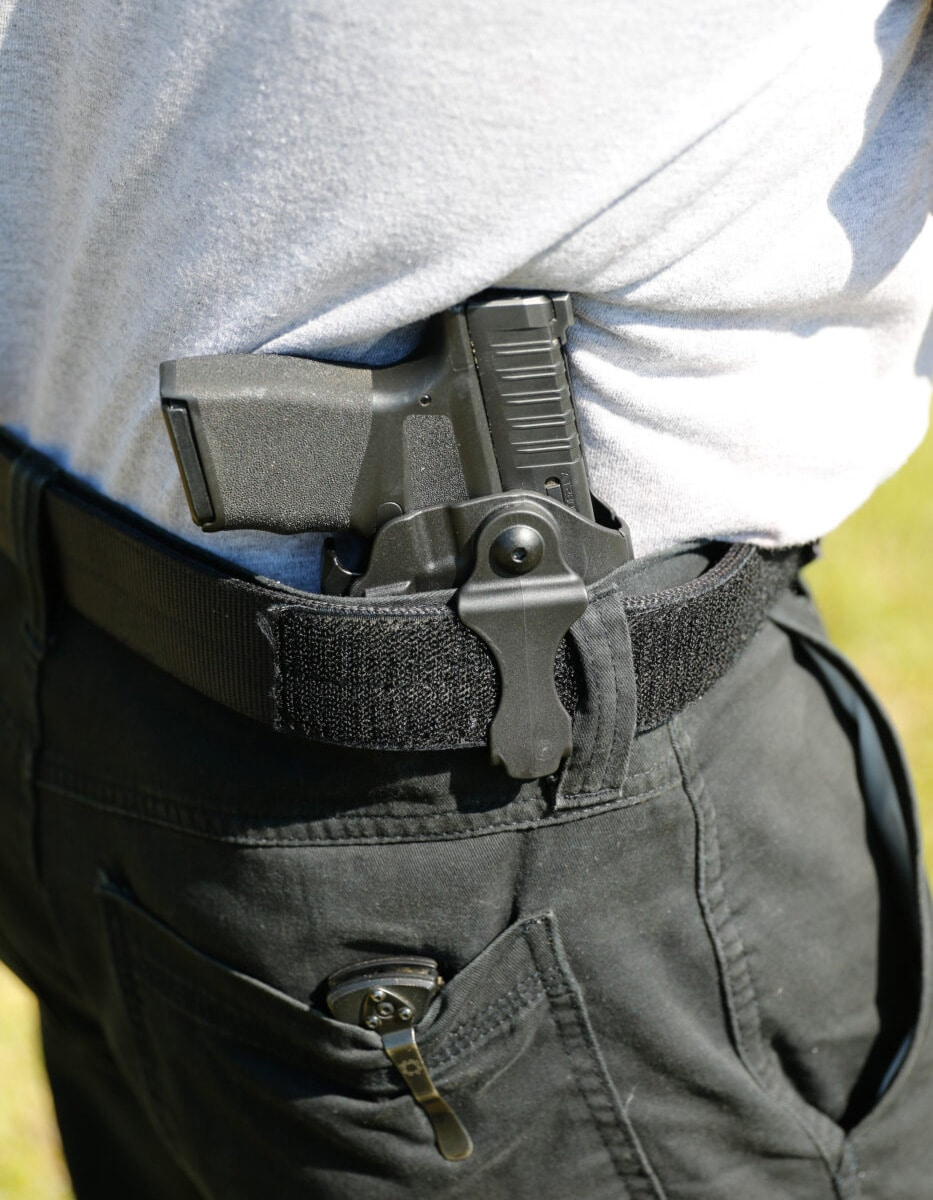 Man carrying Hellcat in a Safariland IWB carry rig