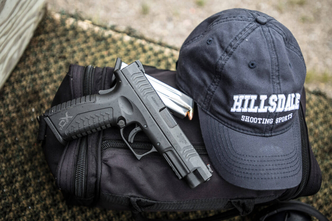 Springfield Armory pistol and Hillsdale College ball cap