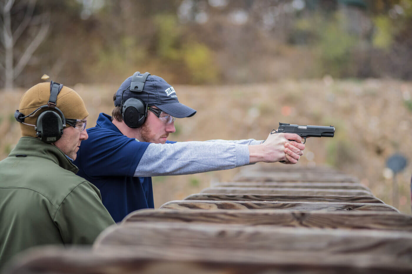 Man teaching a student shooter on the Hillsdale College range