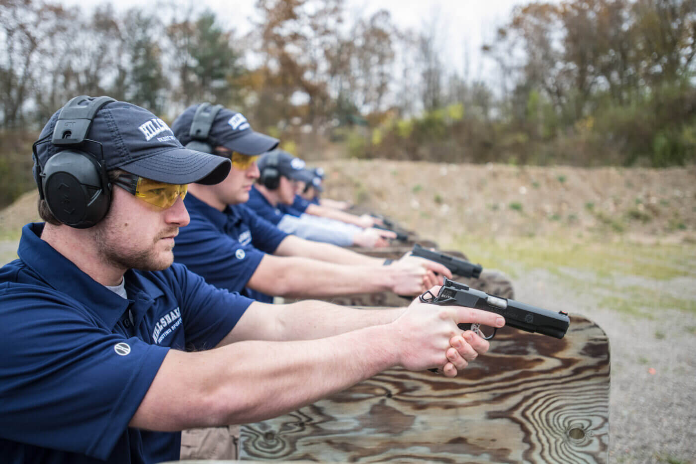 Men in Olympic shooting training on the range at Hillsdale College
