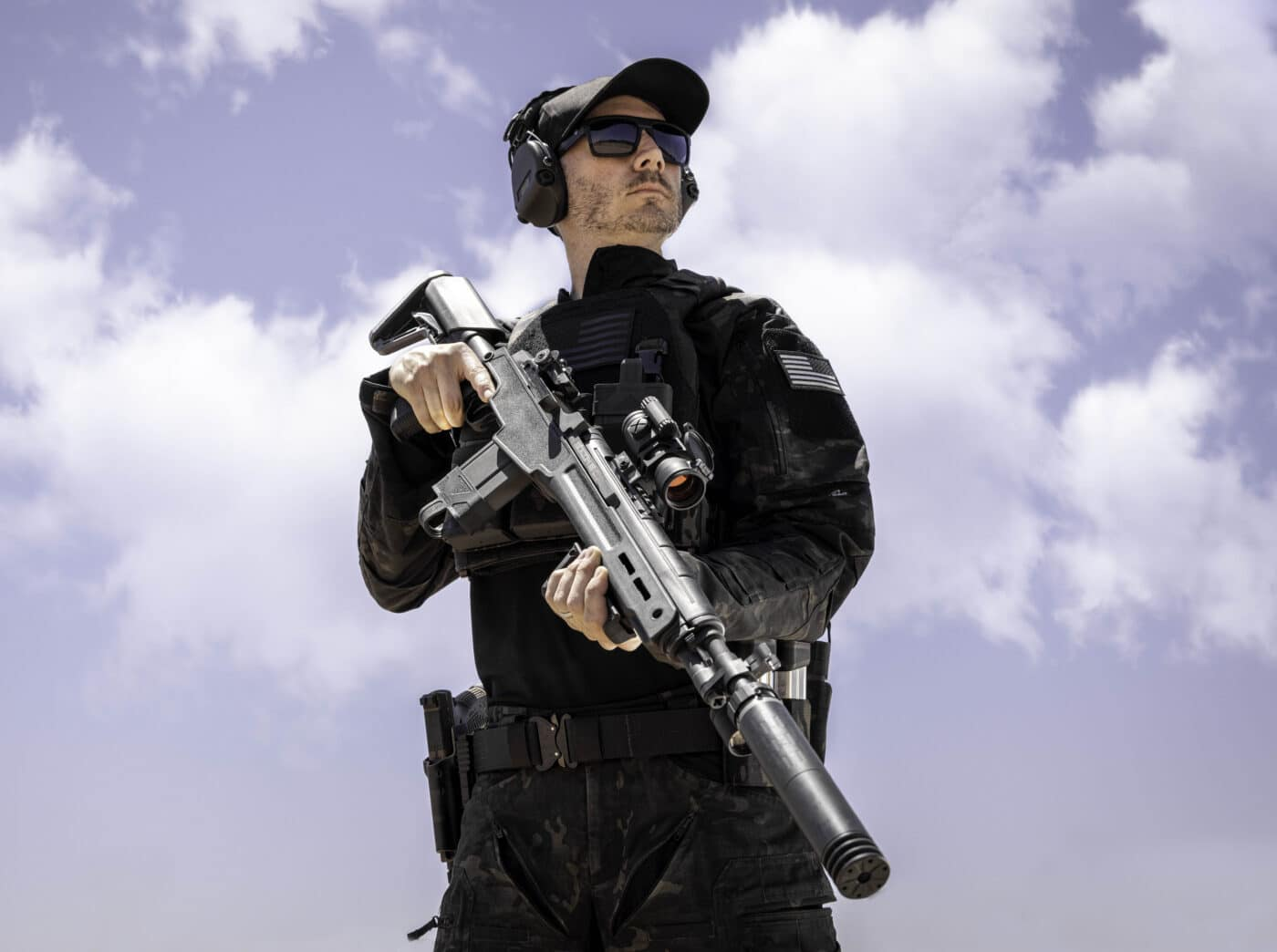 Springfield Armory M1A SOCOM 16 CQB with Silencerco suppressor being held by a man