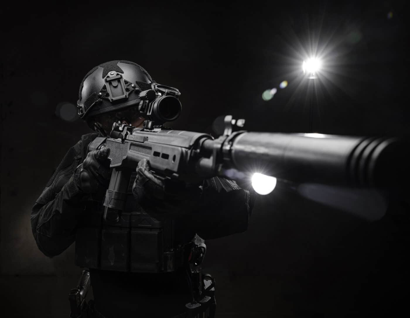Springfield Armory Tactical M1A SOCOM 16 CQB being held by man in armor