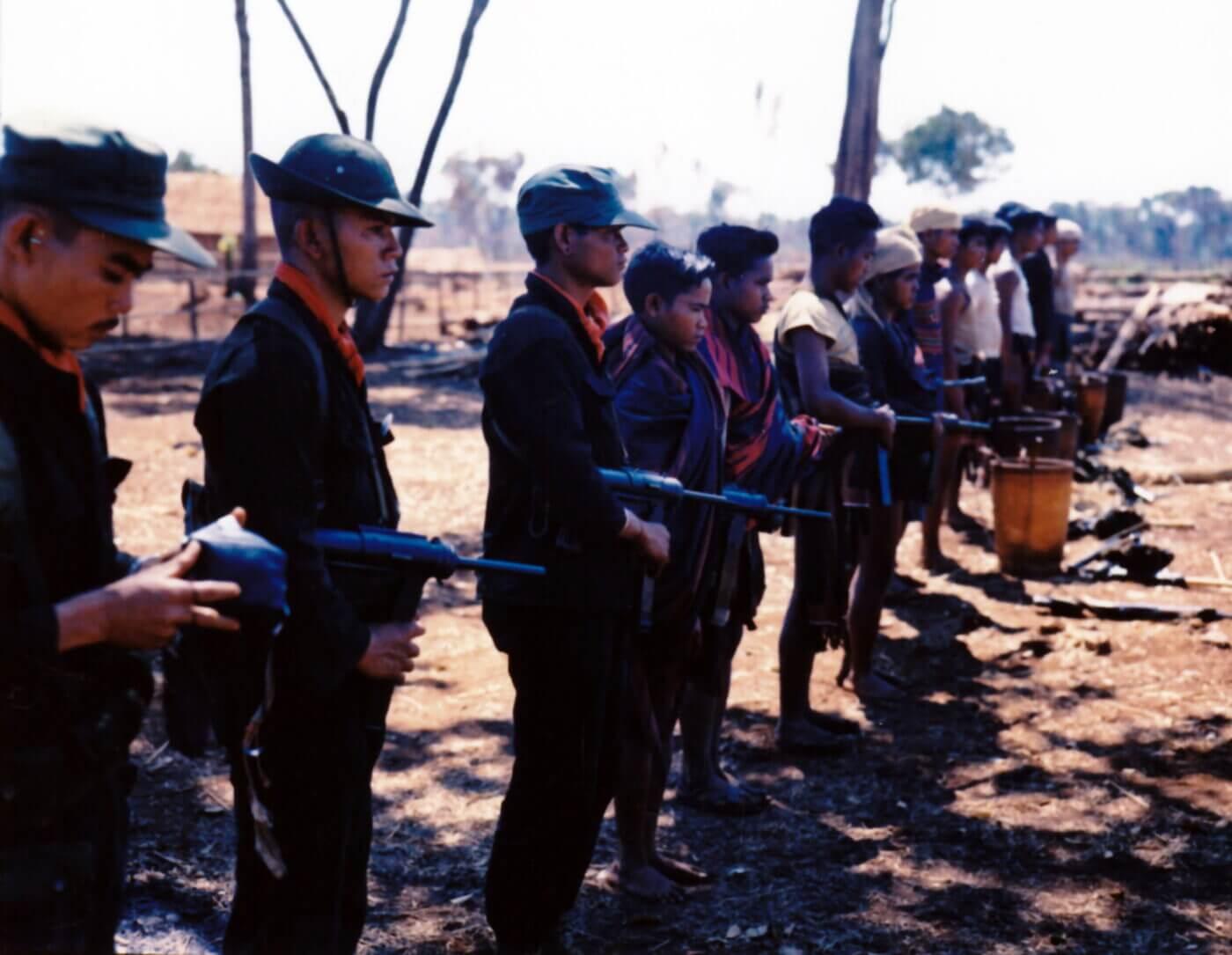 M3 guns held by Montagnard militia men