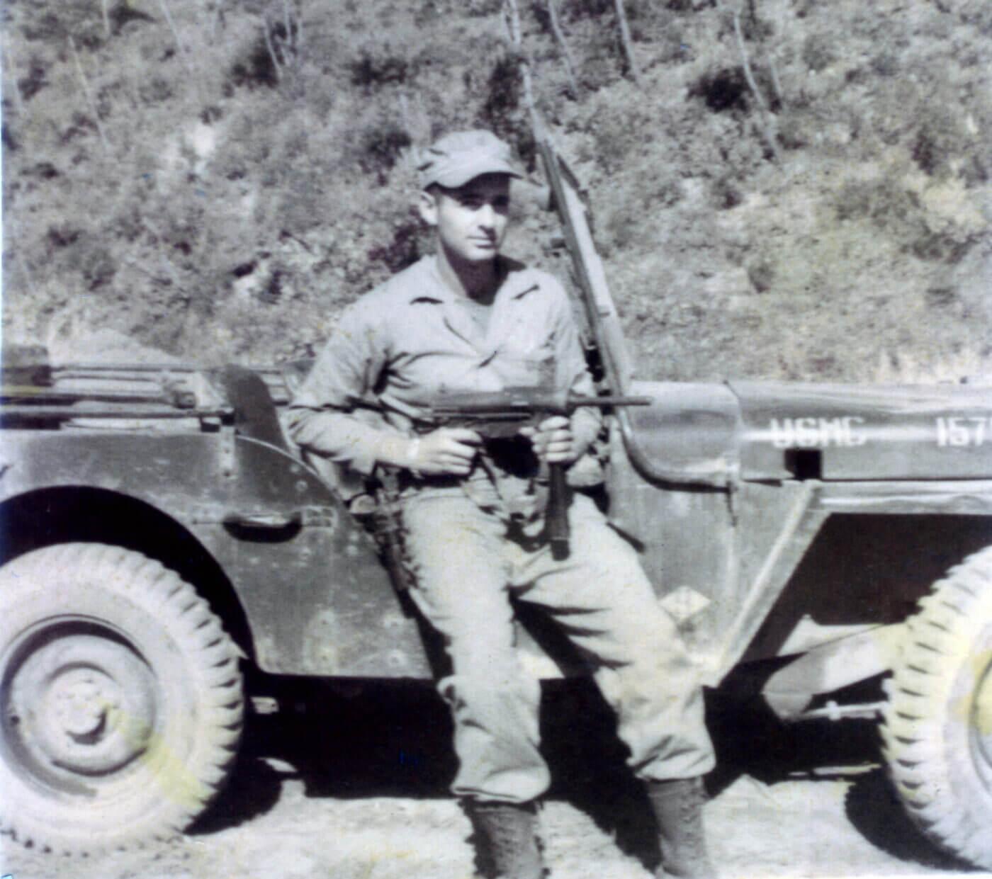 Grease gun held by USMC soldier in 1952 in Korea
