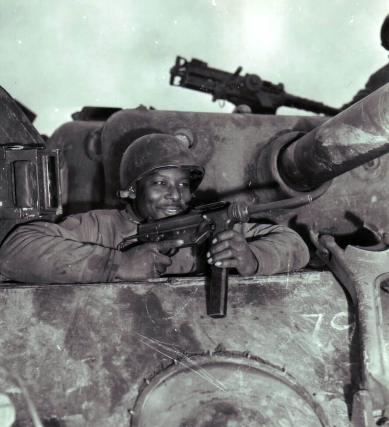 Soldier in tank with M3 grease gun