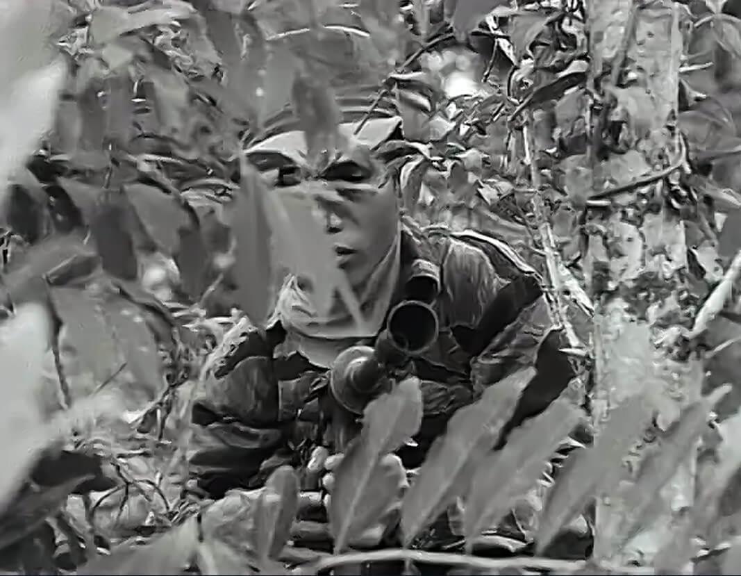 A Montagnard militia man with M3A1 gun