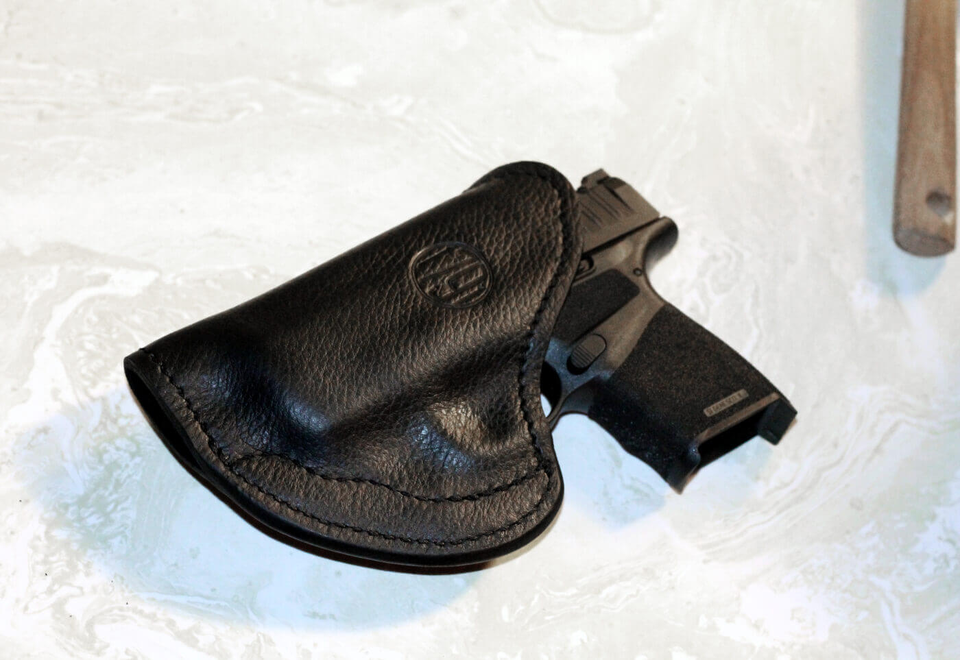 Custom fitting a 1791 Gunleather holster to a Hellcat pistol