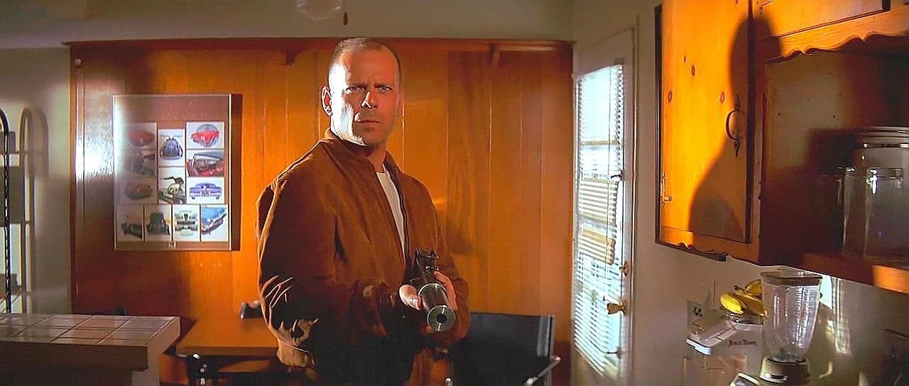 Pulp Fiction actor holding gun with silencer