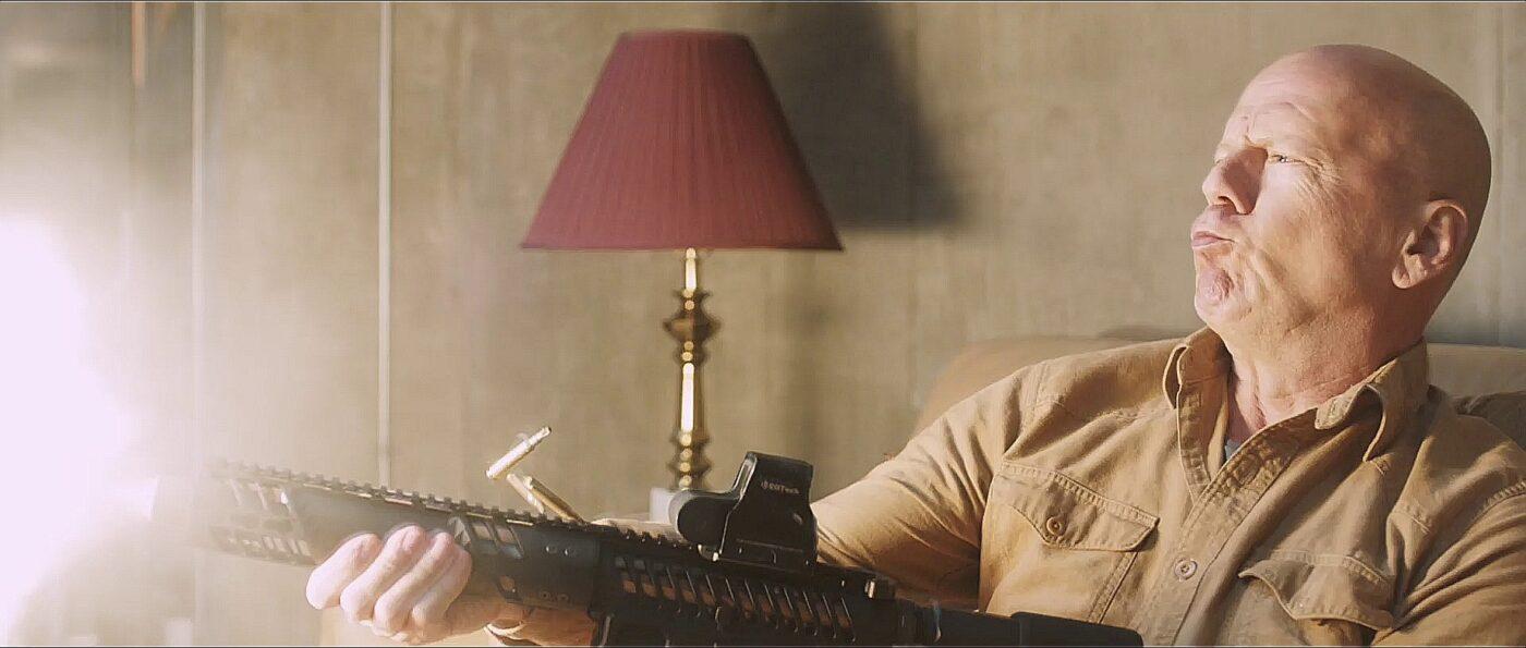 Death Wish movie still with actor holding gun