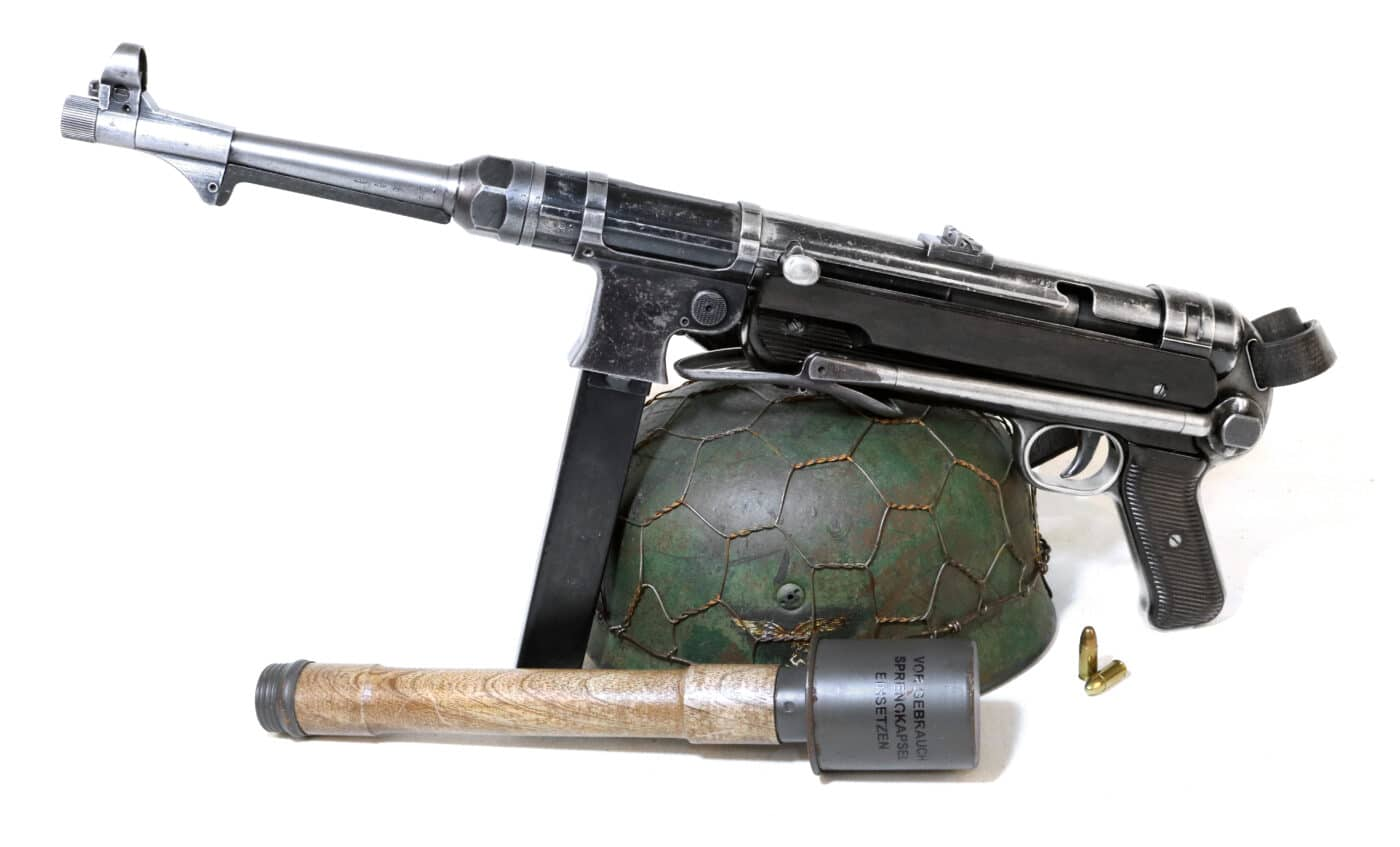 German MP40 with helmet and stick grenade