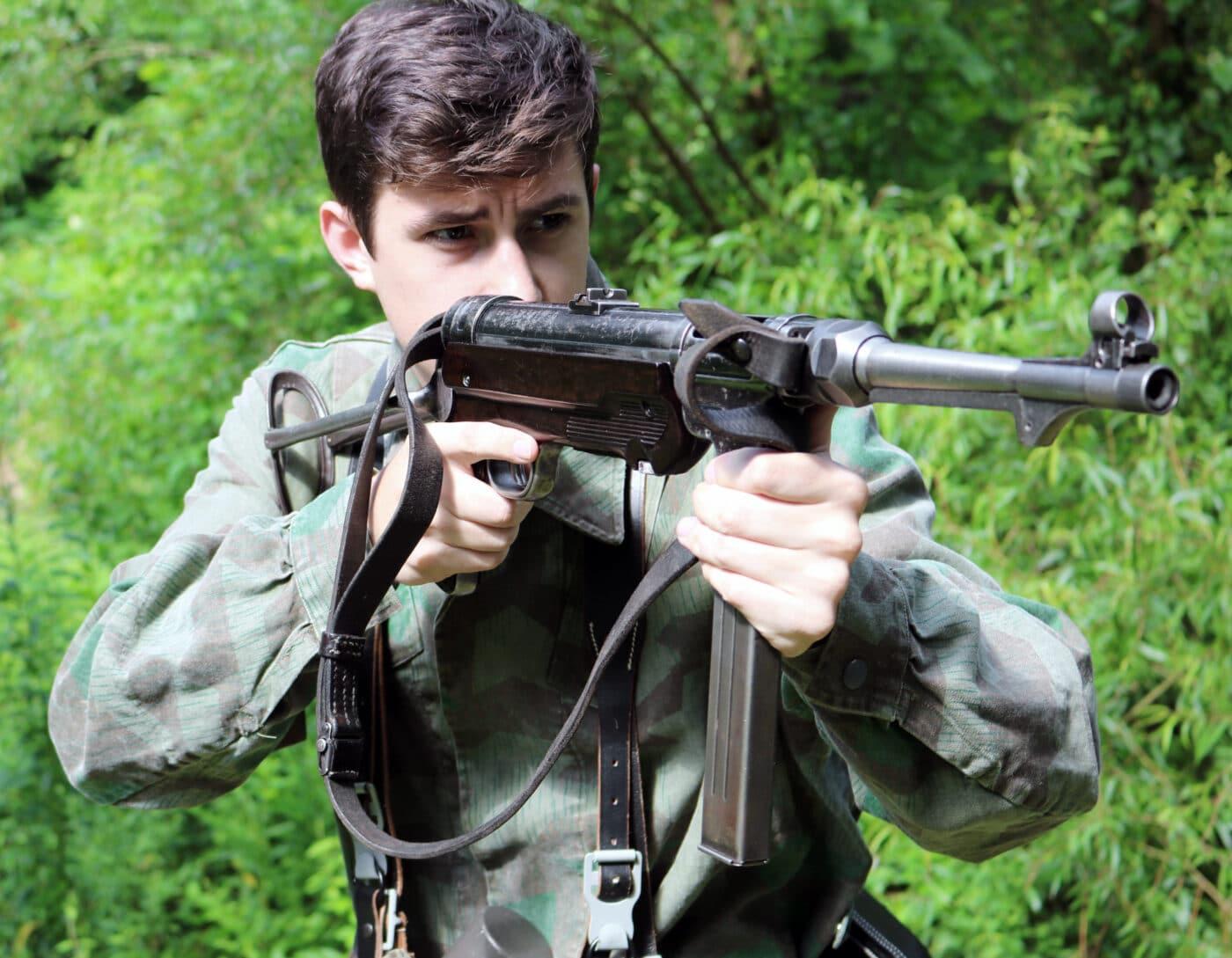 Man shooting an MP40 SMG on the range