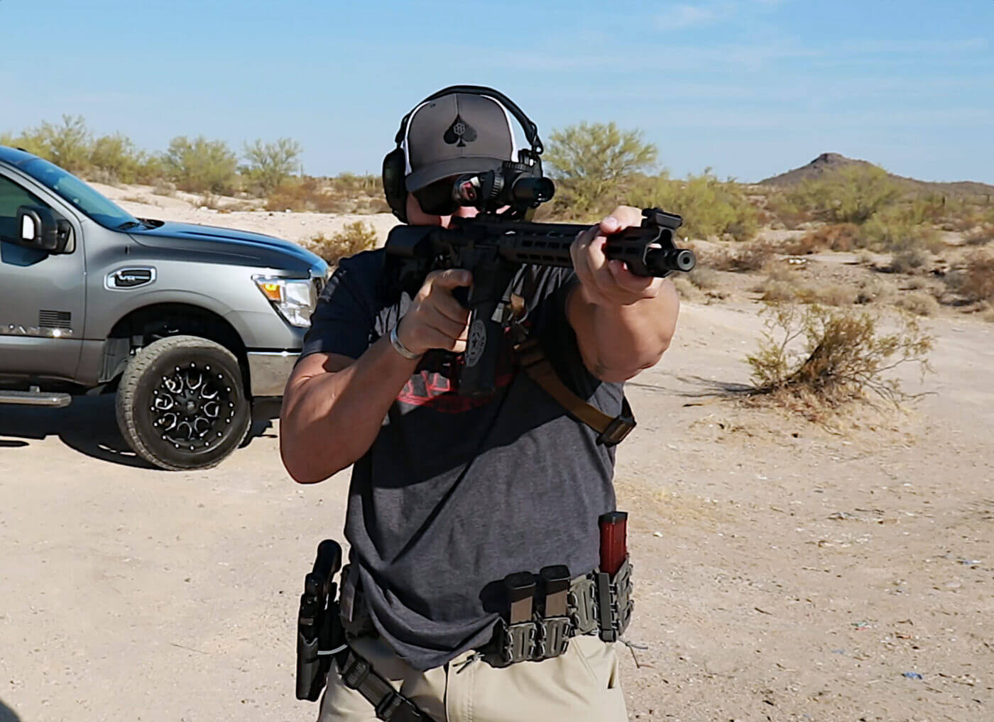 Man testing the Riton optic on the range with a SAINT Victor rifle