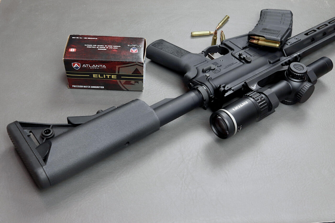 Atlanta Arms ammo with SAINT Victor rifle with Riton scope mounted
