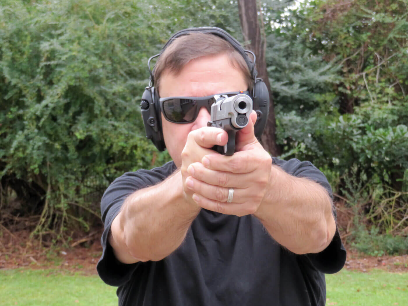 Man shooting the Springfield Armory EMP Concealed Carry Contour pistol on the range