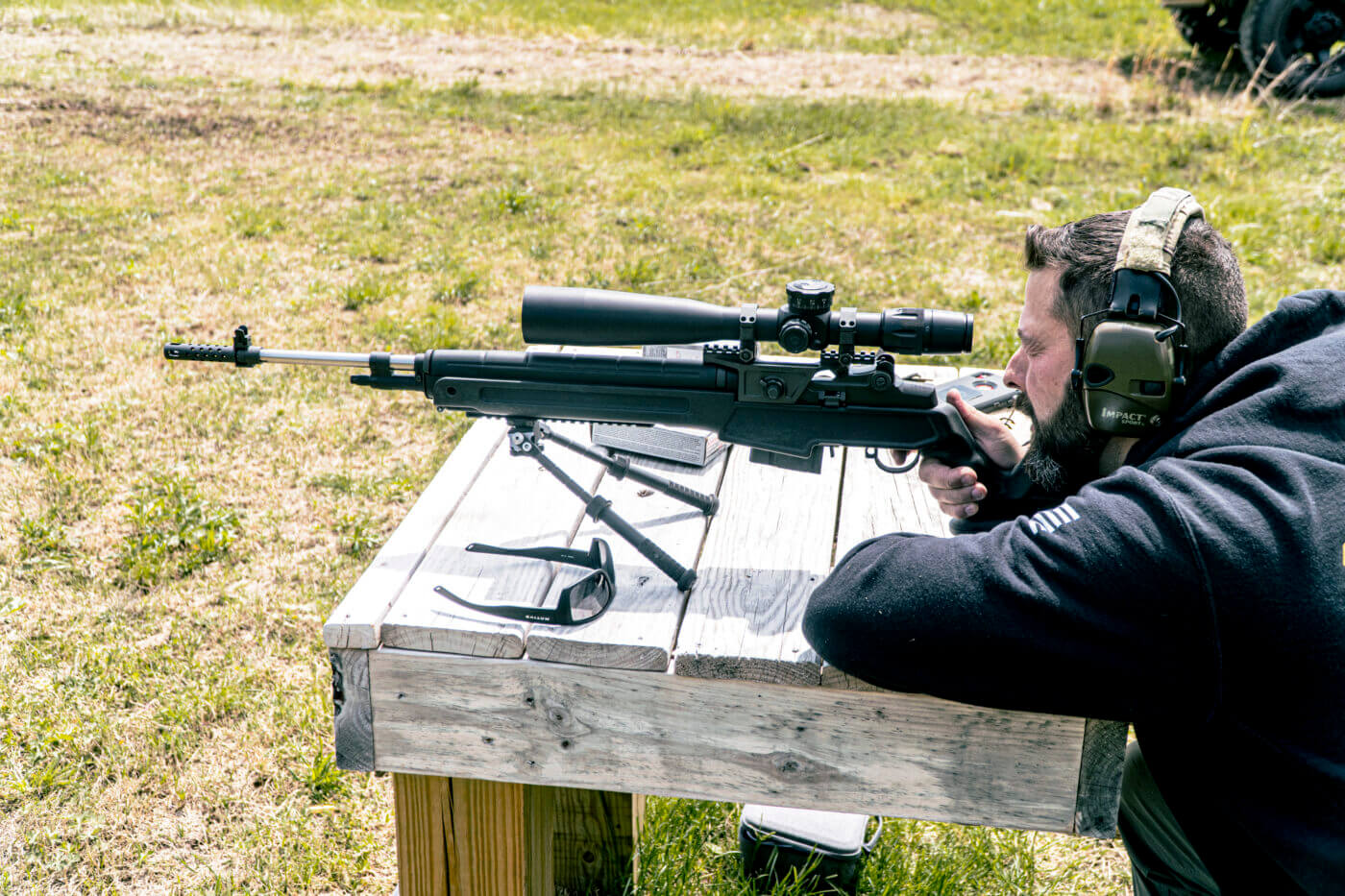 Man shooting the M1A Loaded Precision from a bench for groups