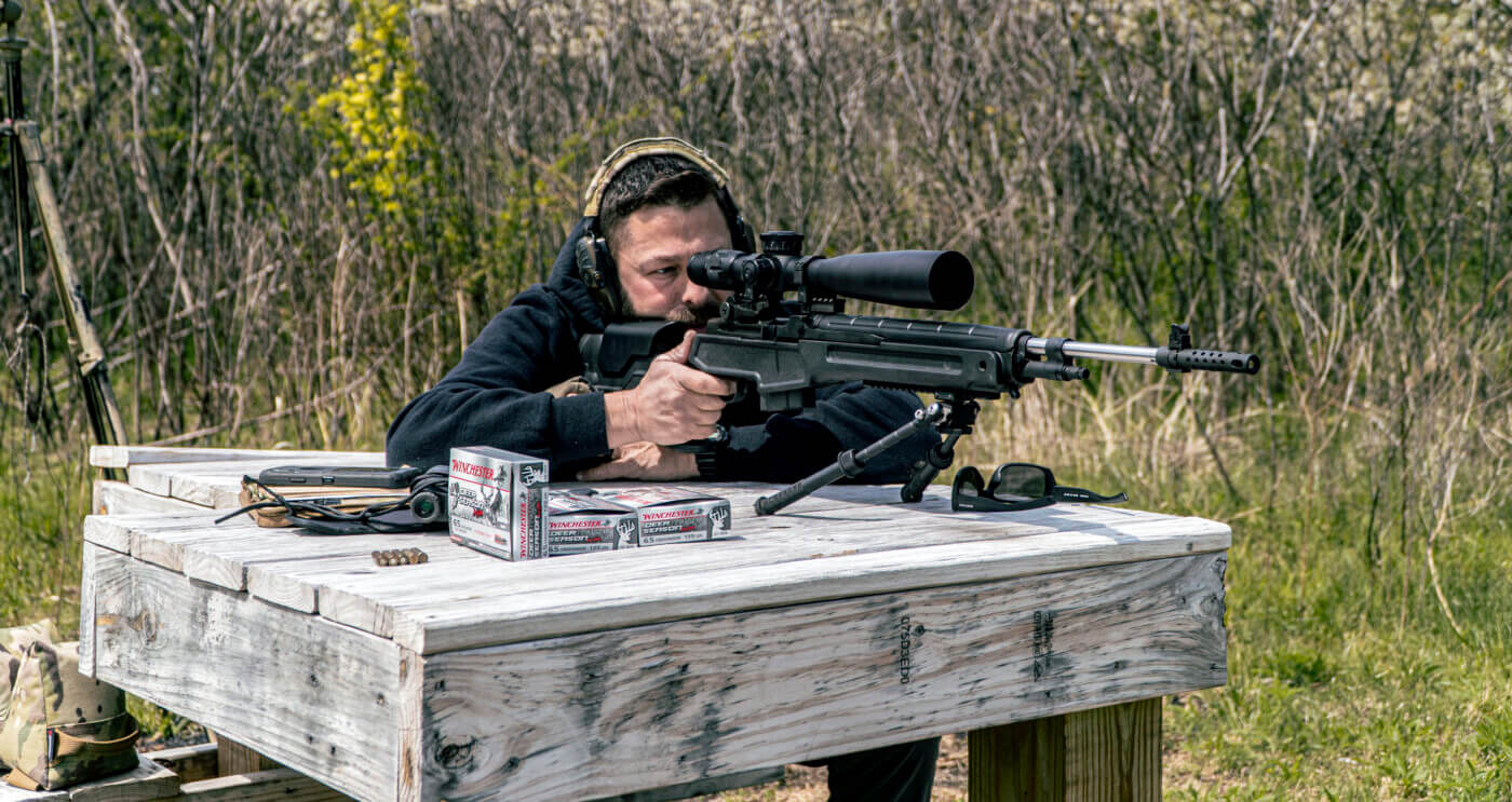 Man field testing the M1A Loaded Precision rifle