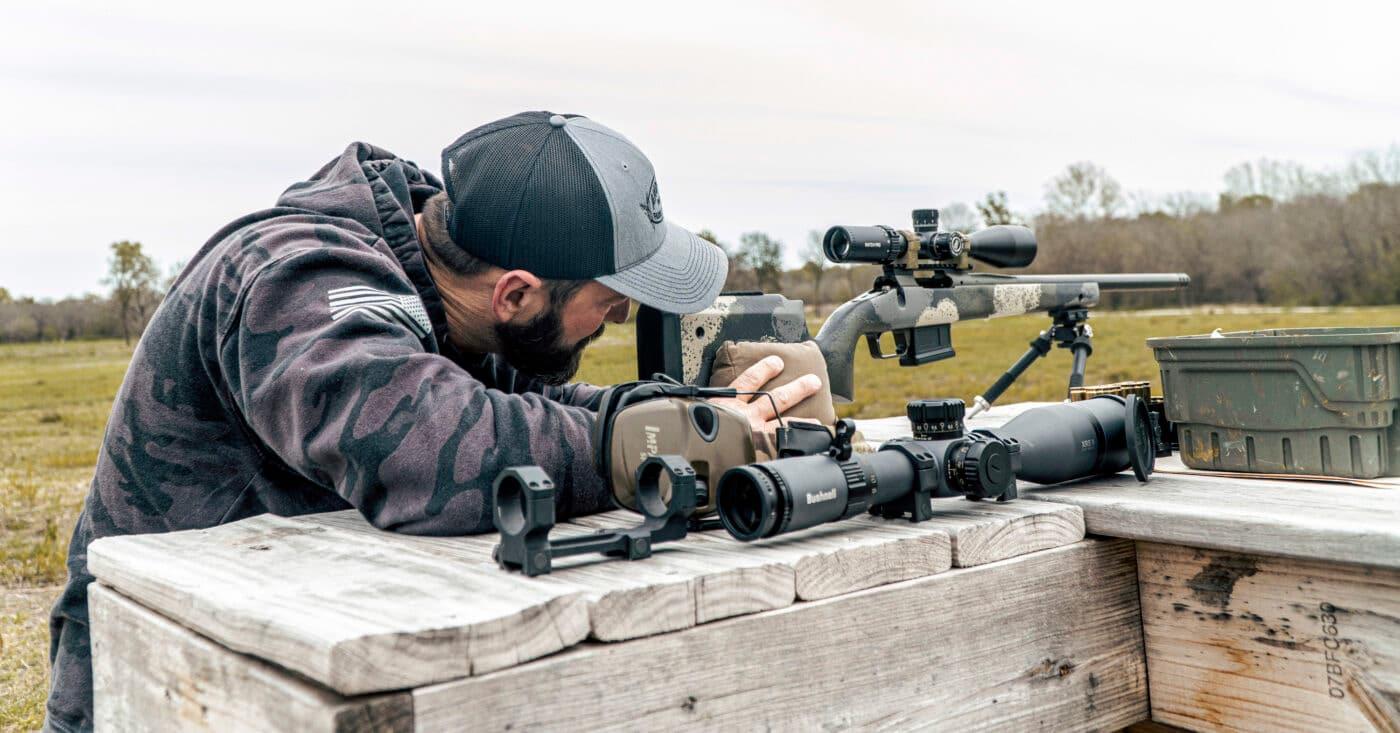 Man using sandbags to support rifle